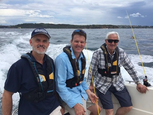 Neil Patchett left educates Rob's dad on the importance of wearing life jackets